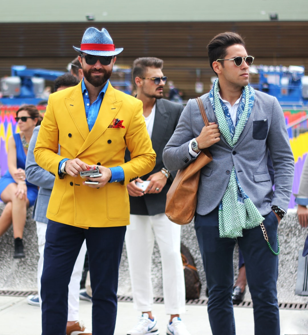 I took this photo while on photography assignment at Pitti Uomo, the largest menswear fashion tradeshow in the world, in Florence, Italy. At Pitti there is a square where key players in mens fashion network with eachother and show their sartorial style.