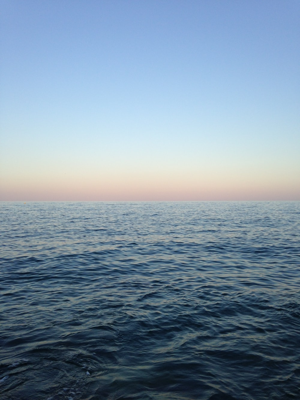 ocean near blue sky at daytime