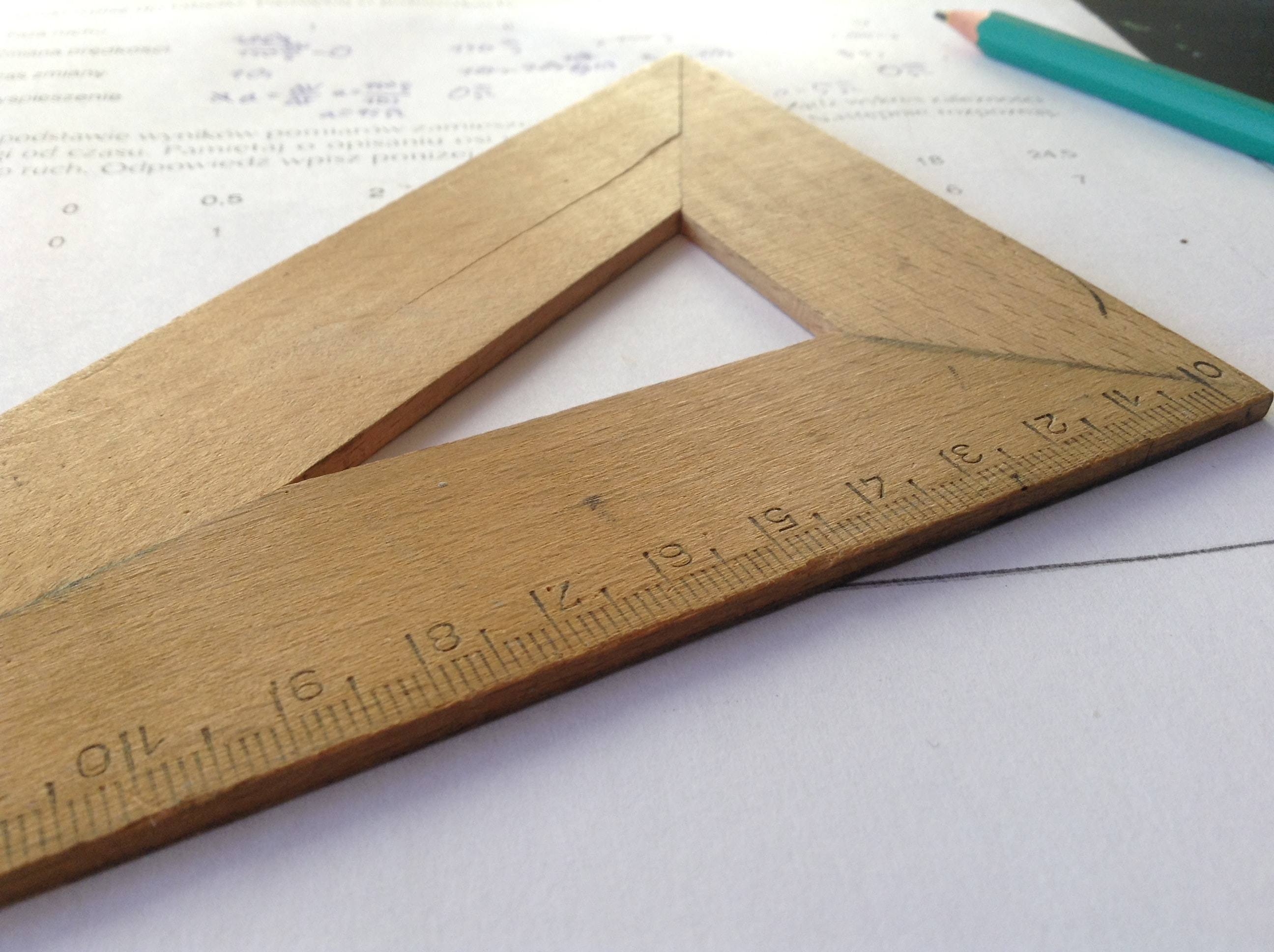brown wooden triangle ruler