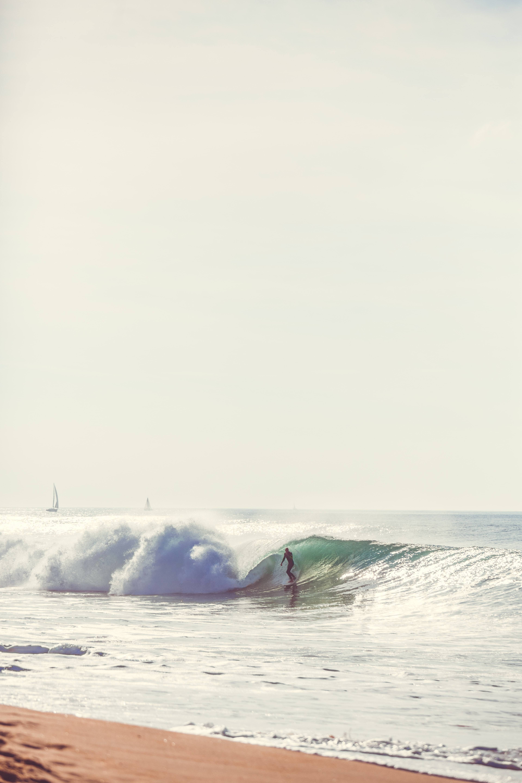 person surfing near seashore