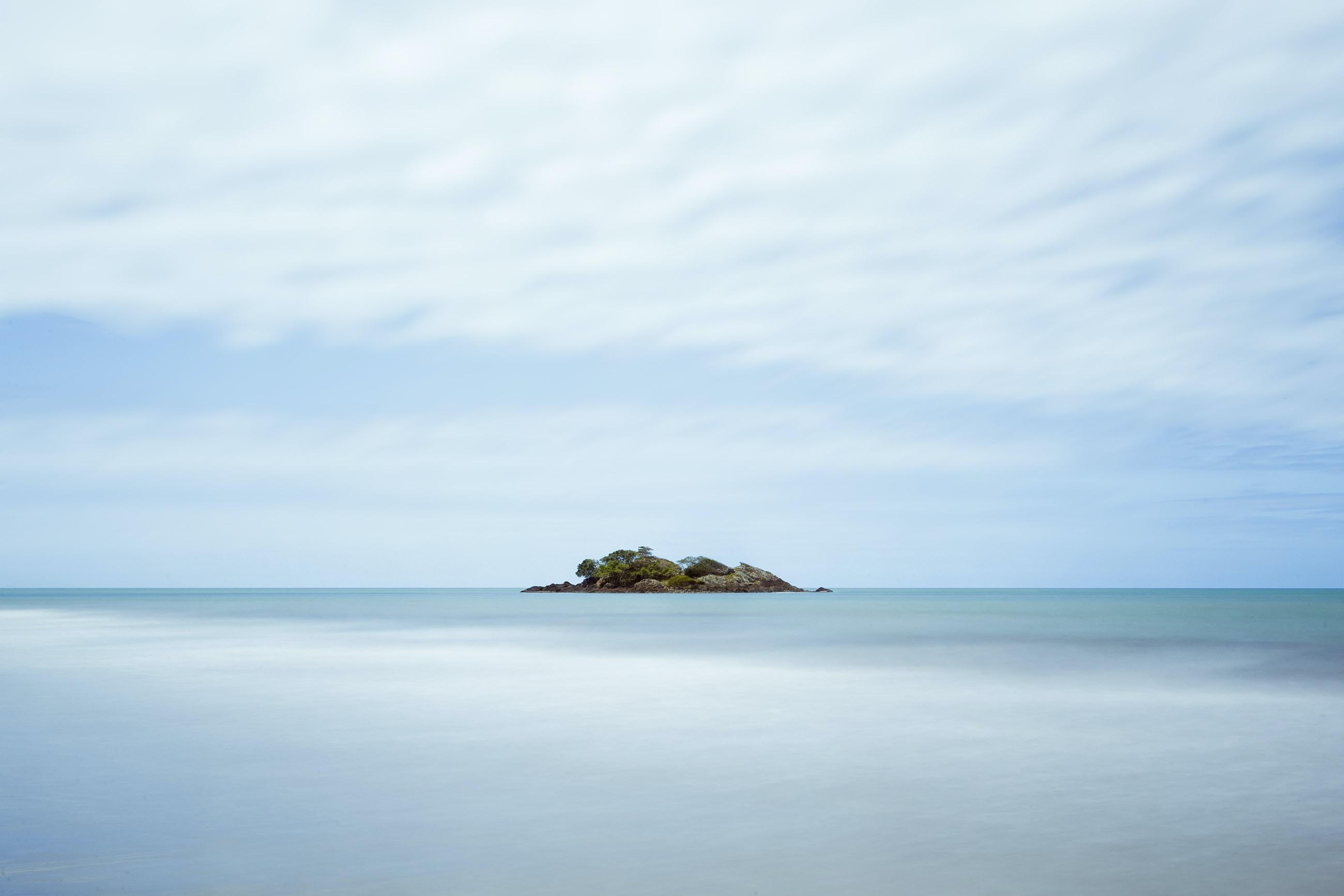 brown stone in sea