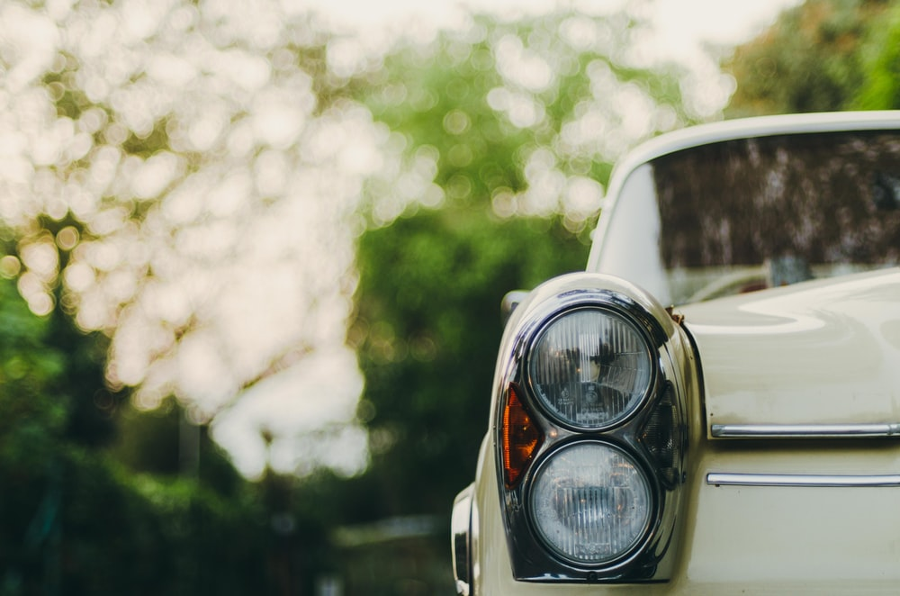 selective focus photography of vehicle headlight