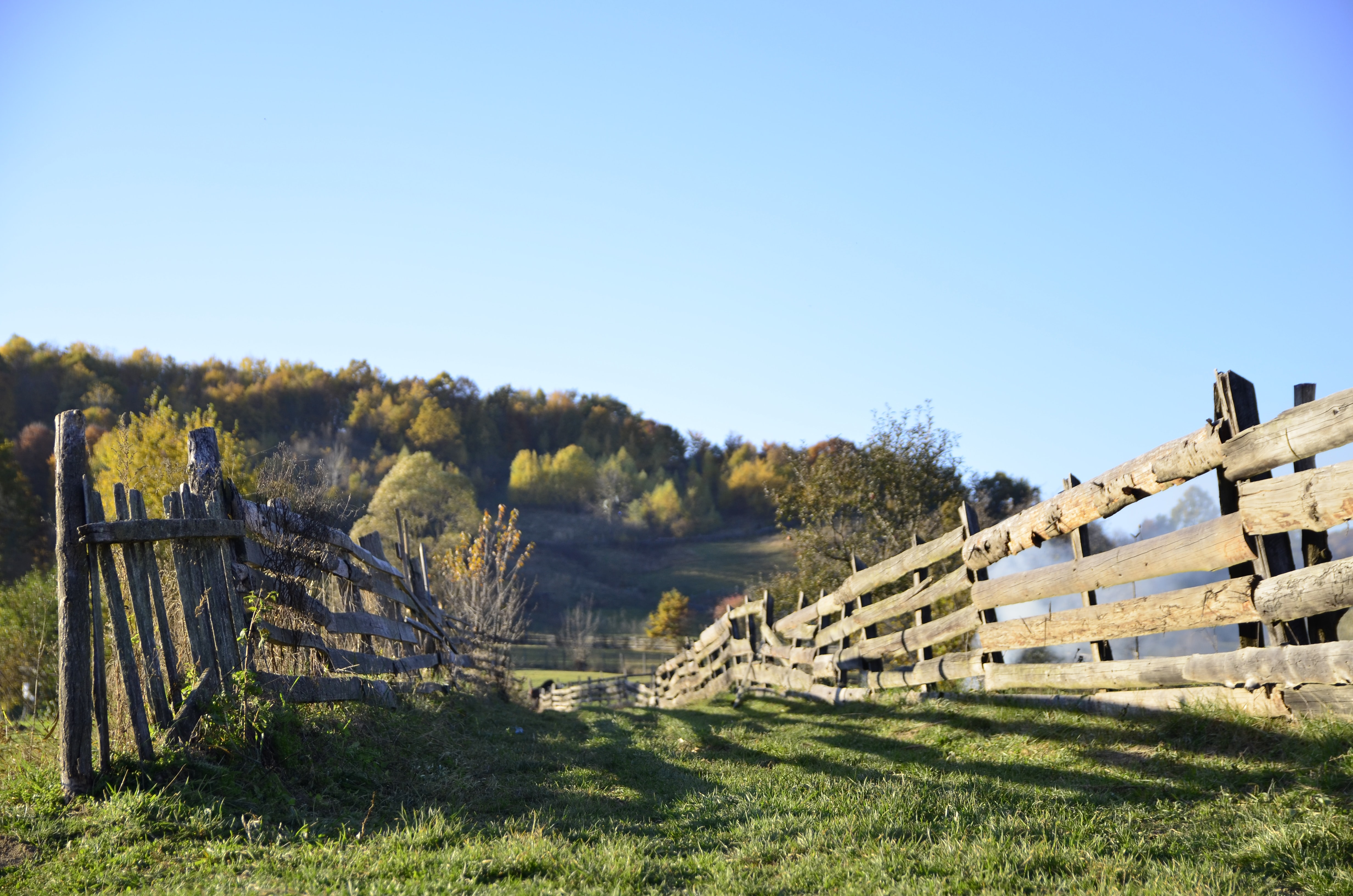 A wooden fence on a hill in the countryside
