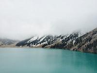 Mountain lake under dense mist