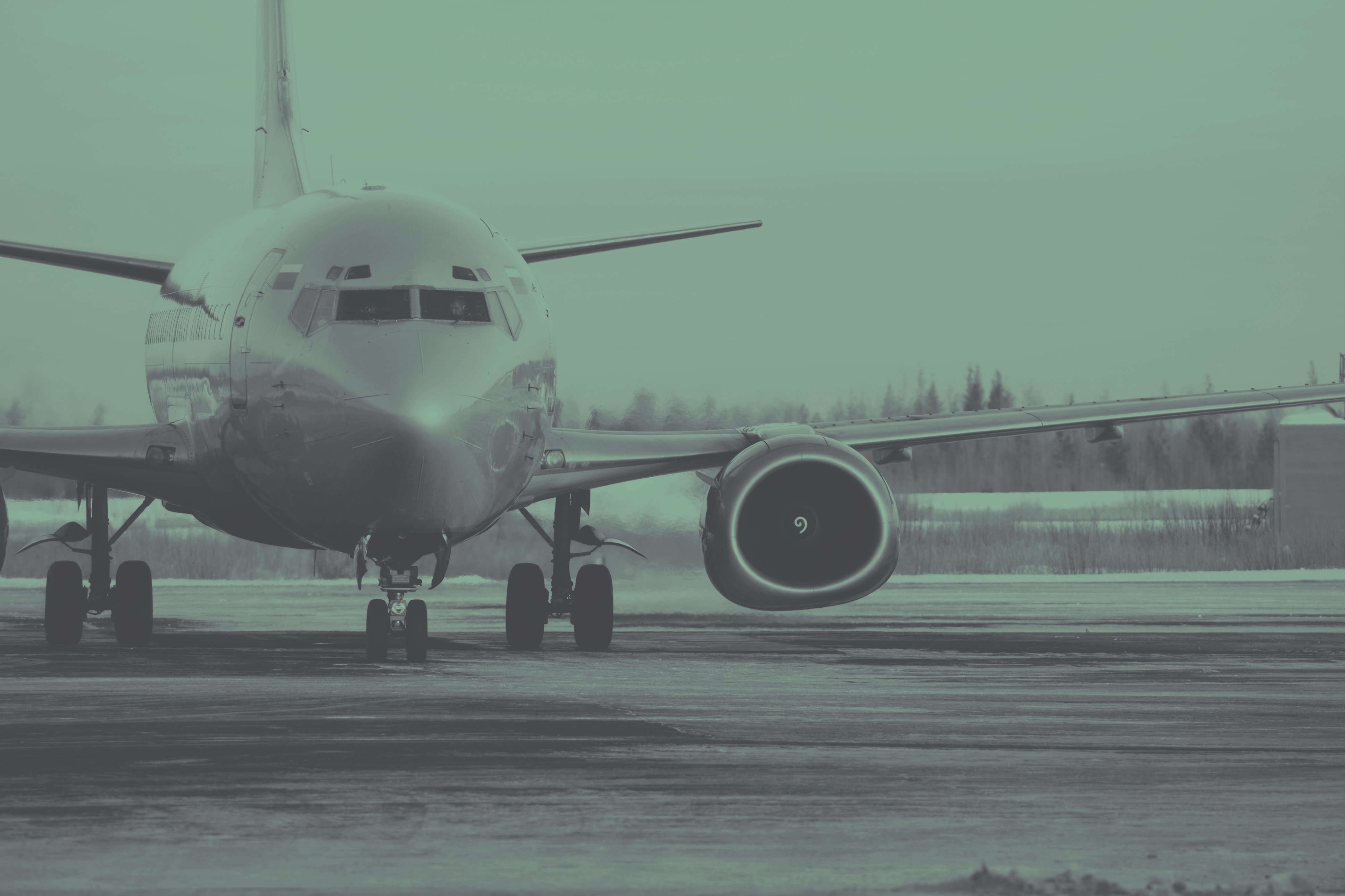 grayscale photo of commercial airplane on runway