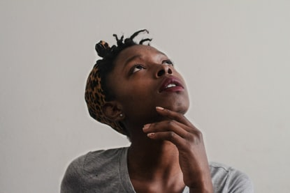 Photo of a woman thinking, by Tachina Lee
