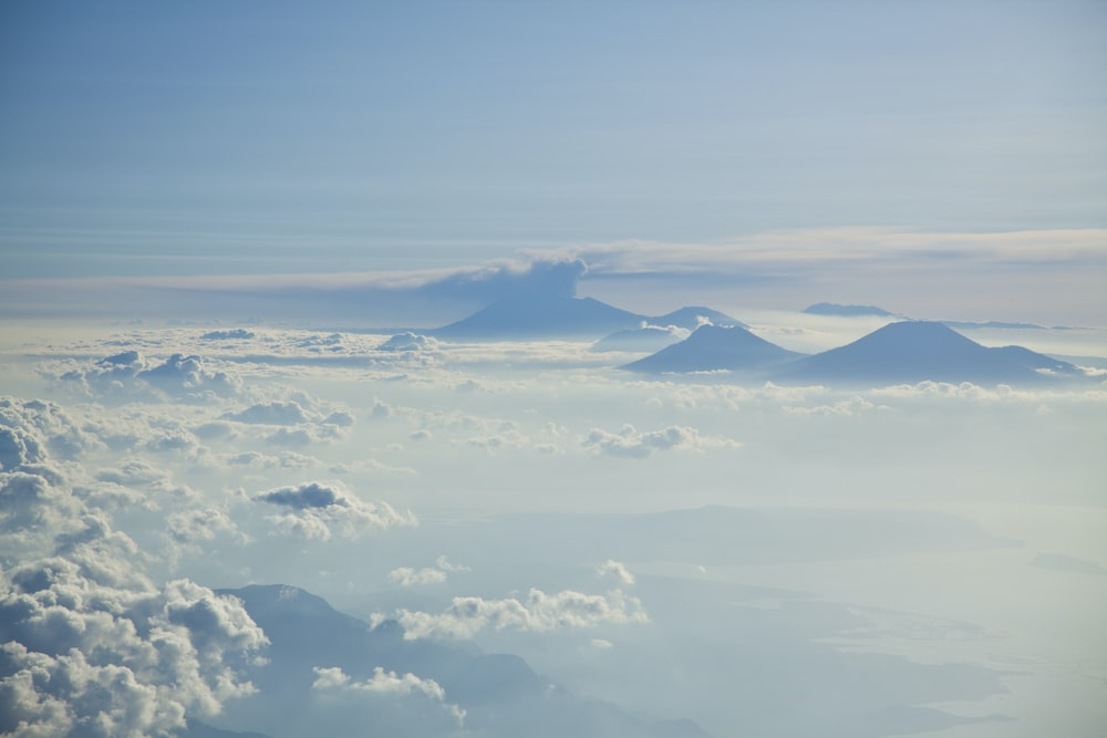 aerial photograph of clouds and mountain