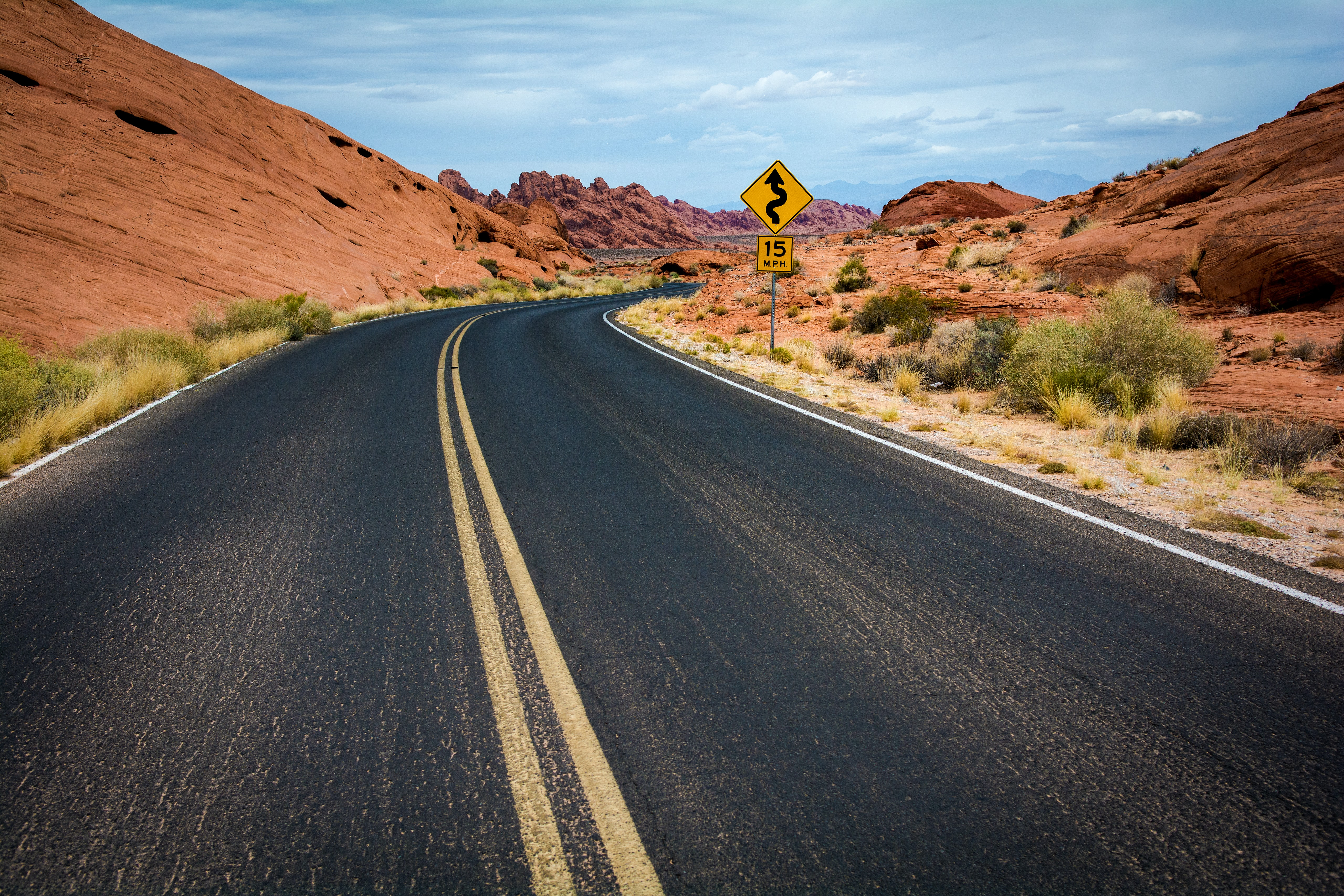 A winding asphalt road through the sandstone landscape of the Valley of Fire