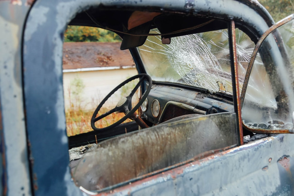 wrecked vehicle with broken windshield