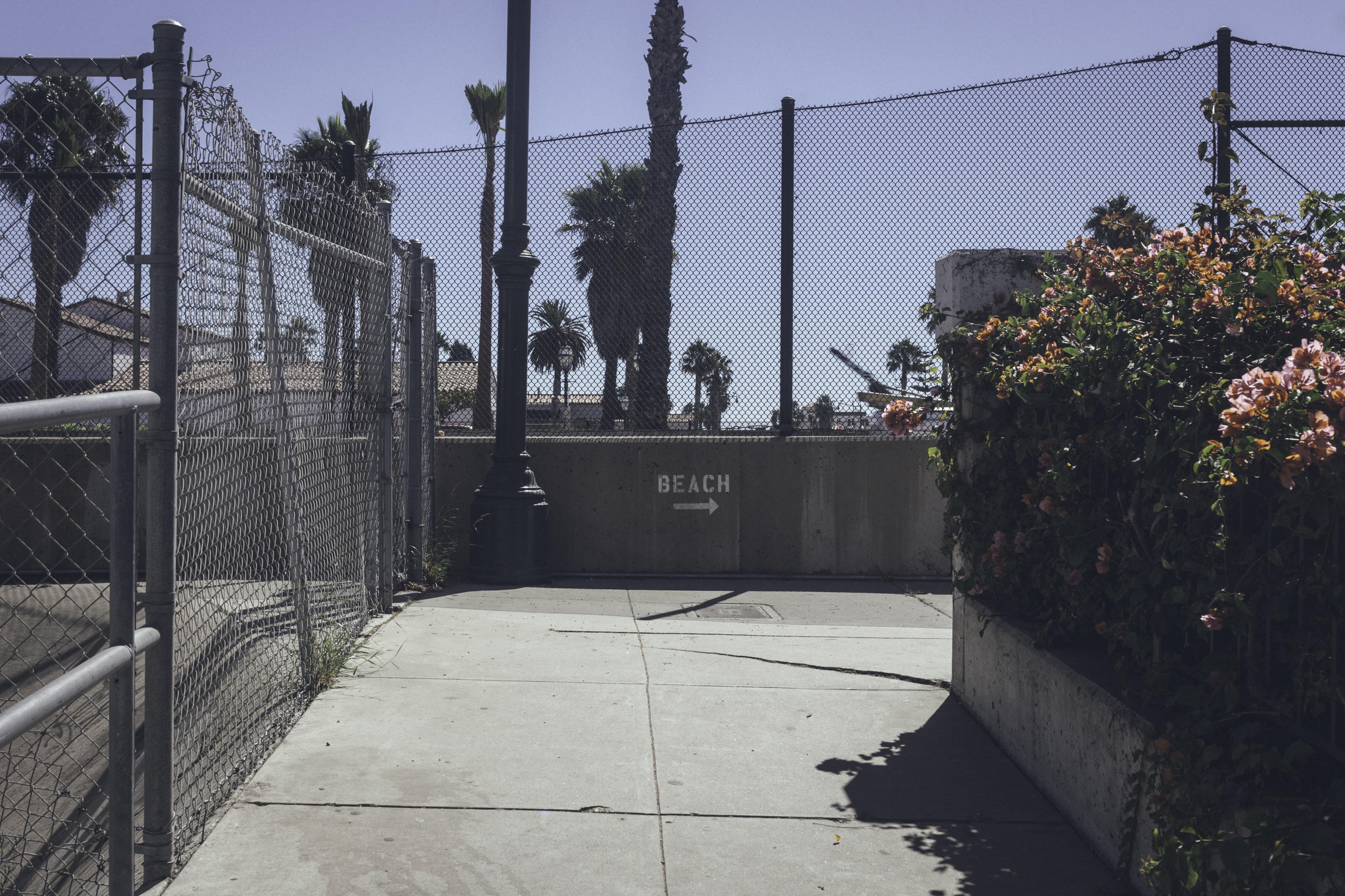 Urban sidewalk by the fences at Santa Barbara