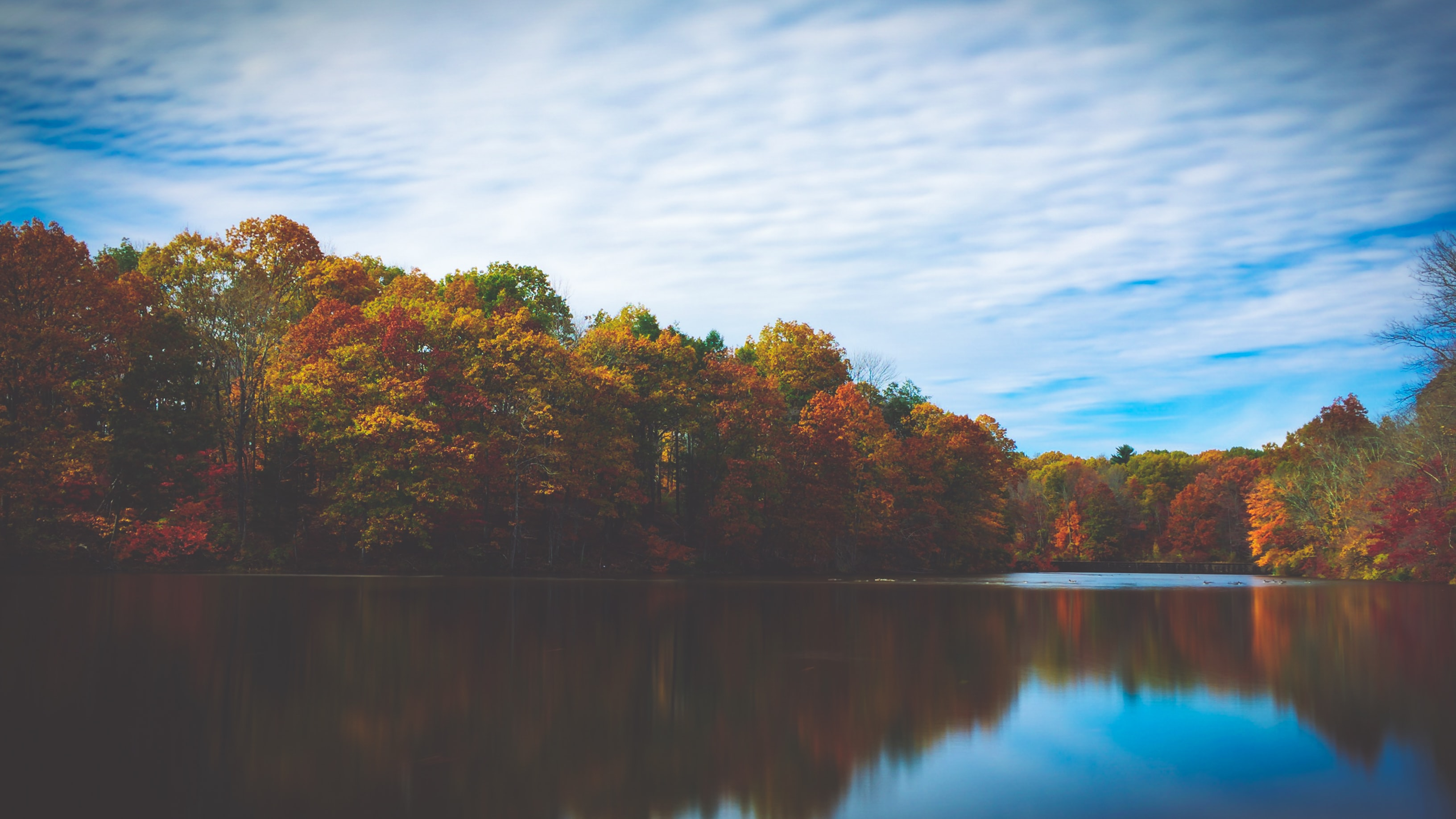 A water level shot of a lake and its wooded shores in the autumn in Mountain Lakes Nature Preserve