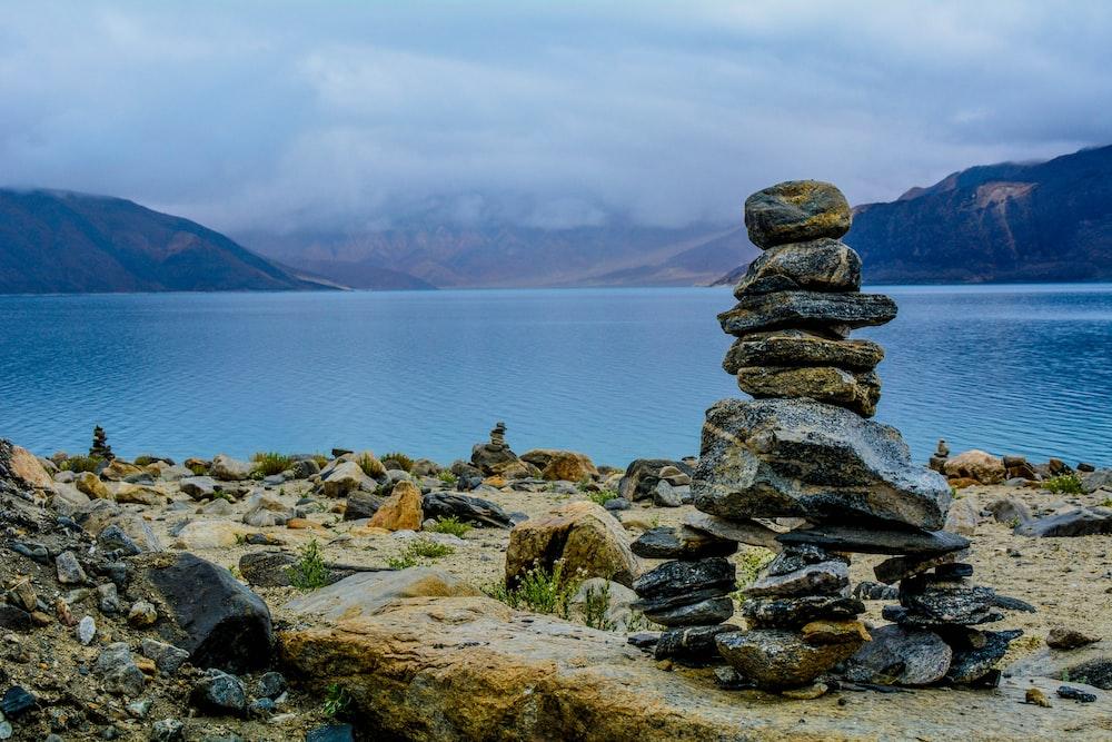 gray rocks stacks on brown surface