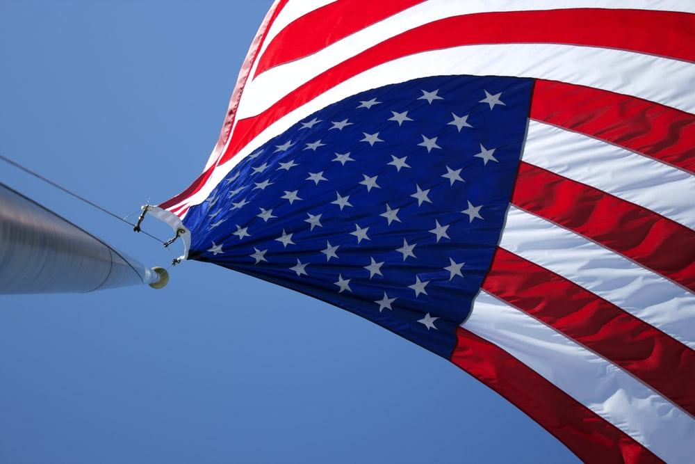 USA flag waving under blue sky