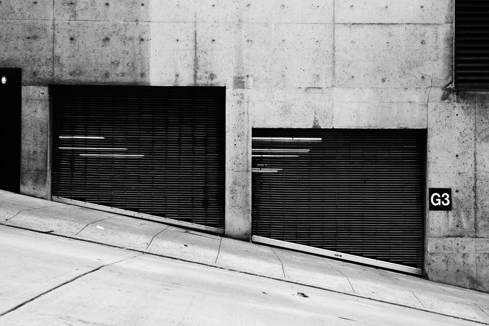 gray concrete wall near pathway