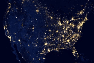 aerial photography of city during night time nasa teams background
