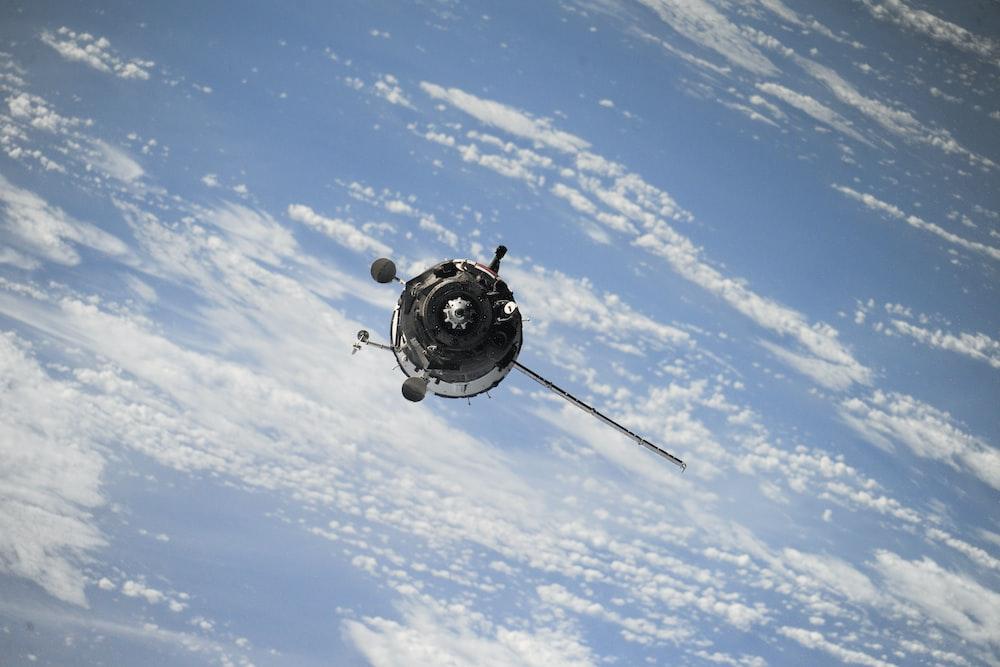 satellite flying on space