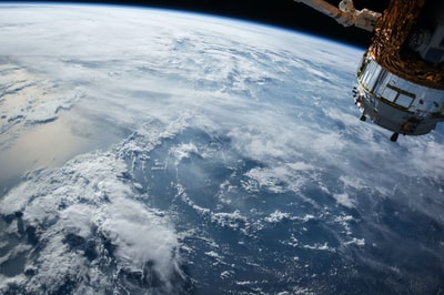 view of earth and satellite space teams background