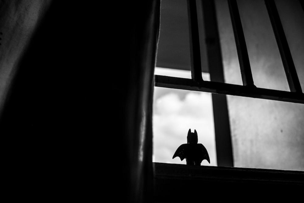 lego batman in window photo by kevin fernandez