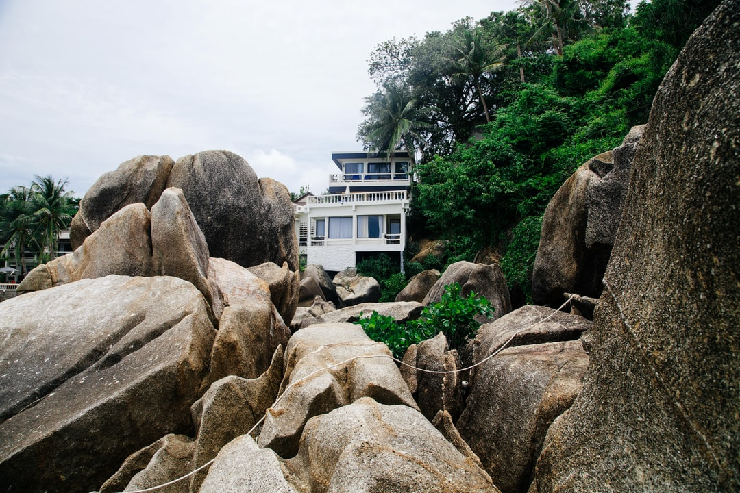 architectural photography of house in the middle of rock formation