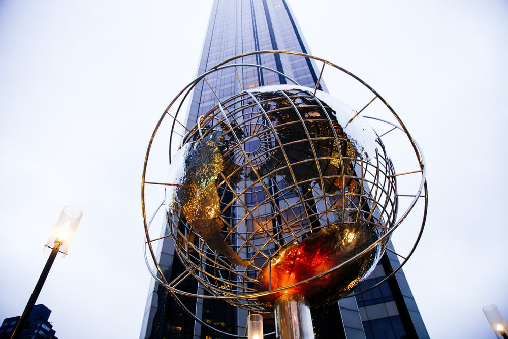 low-angle photography of globe statue