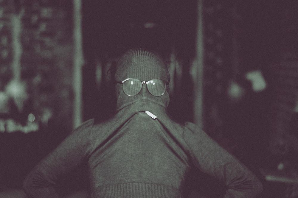 man in black vest and black sunglasses