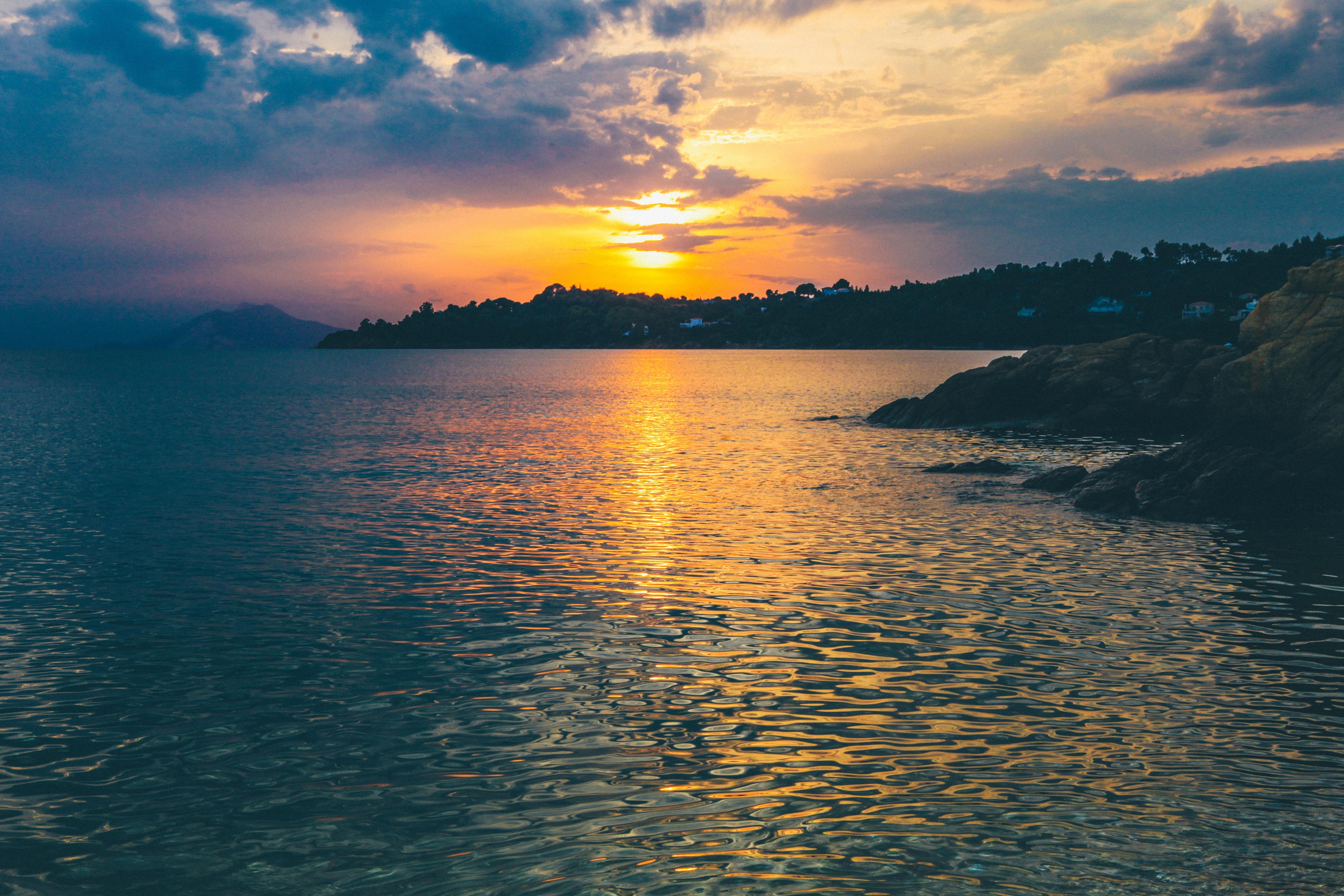 body of water beside shore