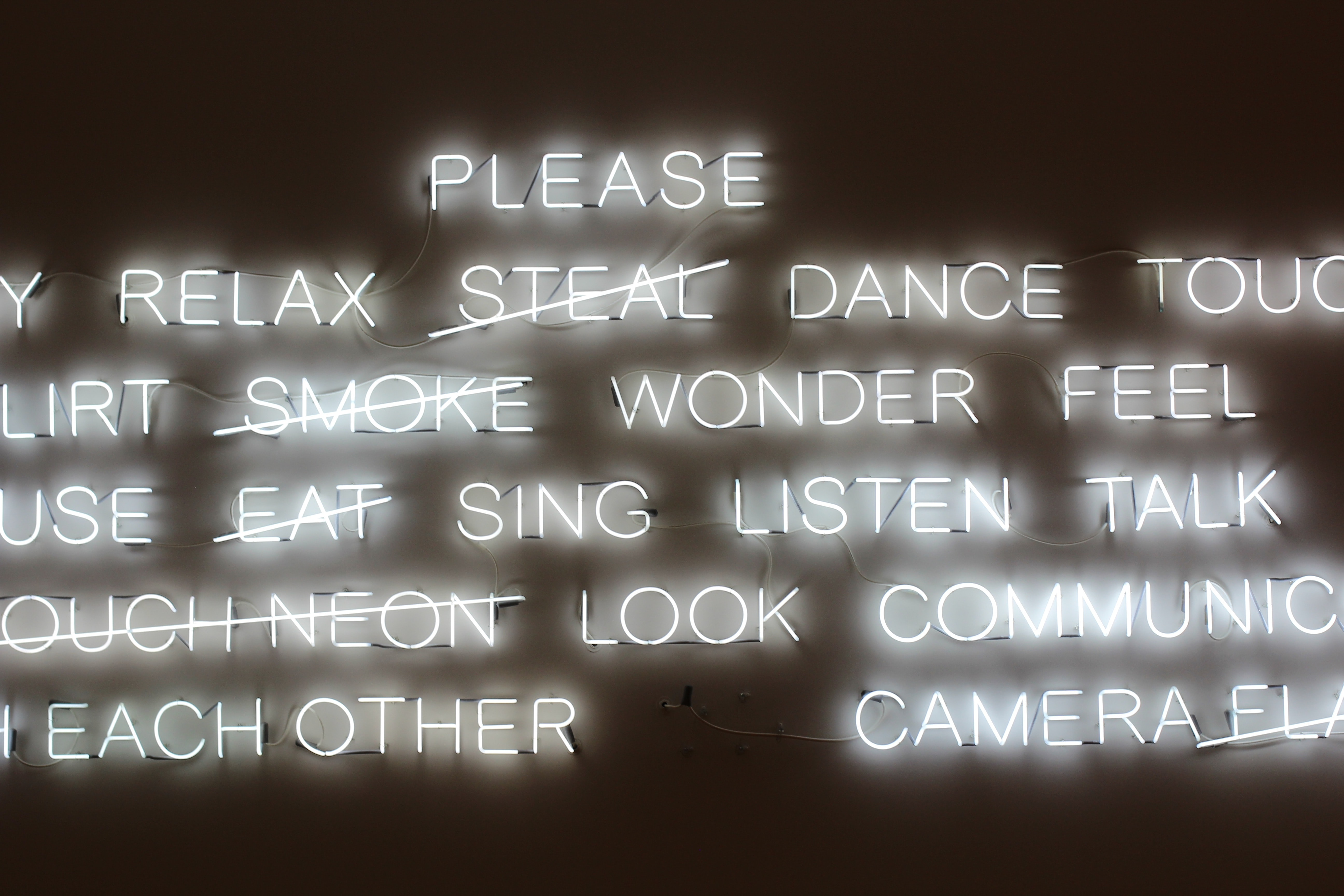 Positive bright white neon white sign on dark background, Museum of Fine Arts, Boston
