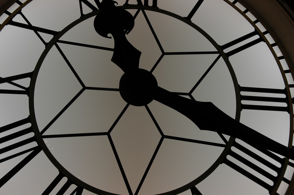 close-up photography of white and black clock