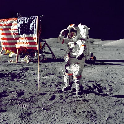 astronaut standing on moon beside