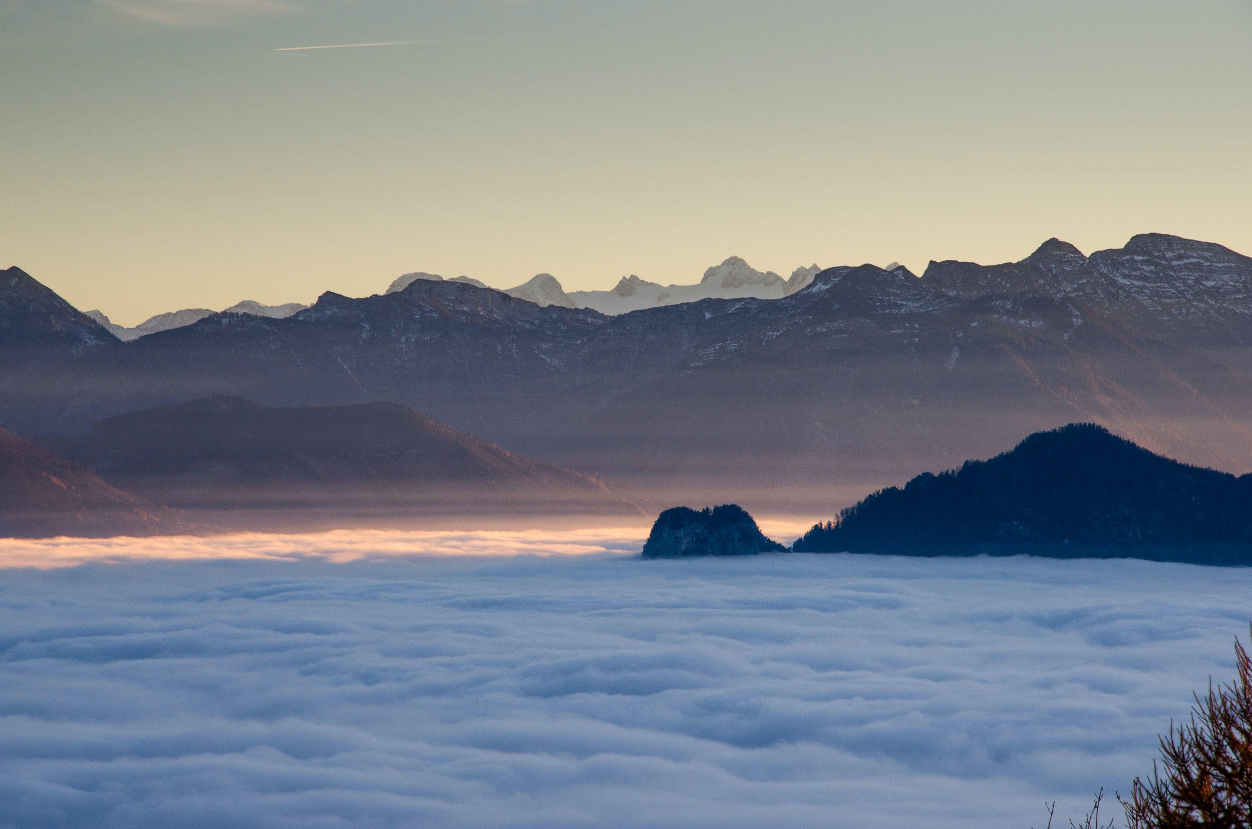 The clouds surrounding the mountains during golden hour in Gmunden