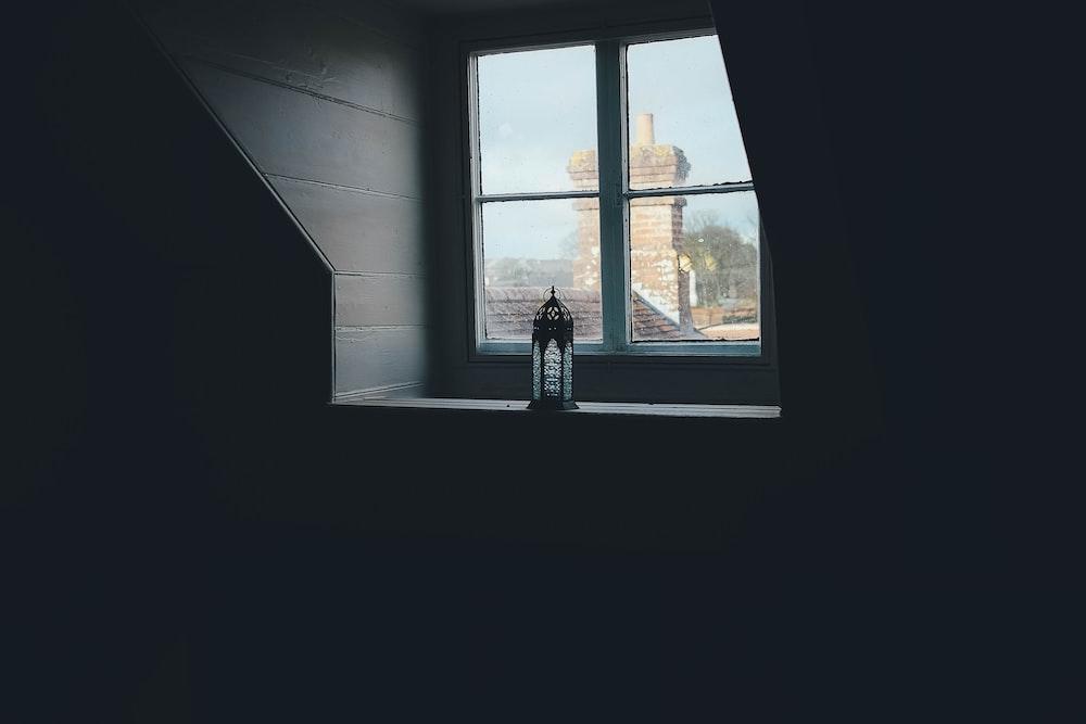 black metal sconce near closed window