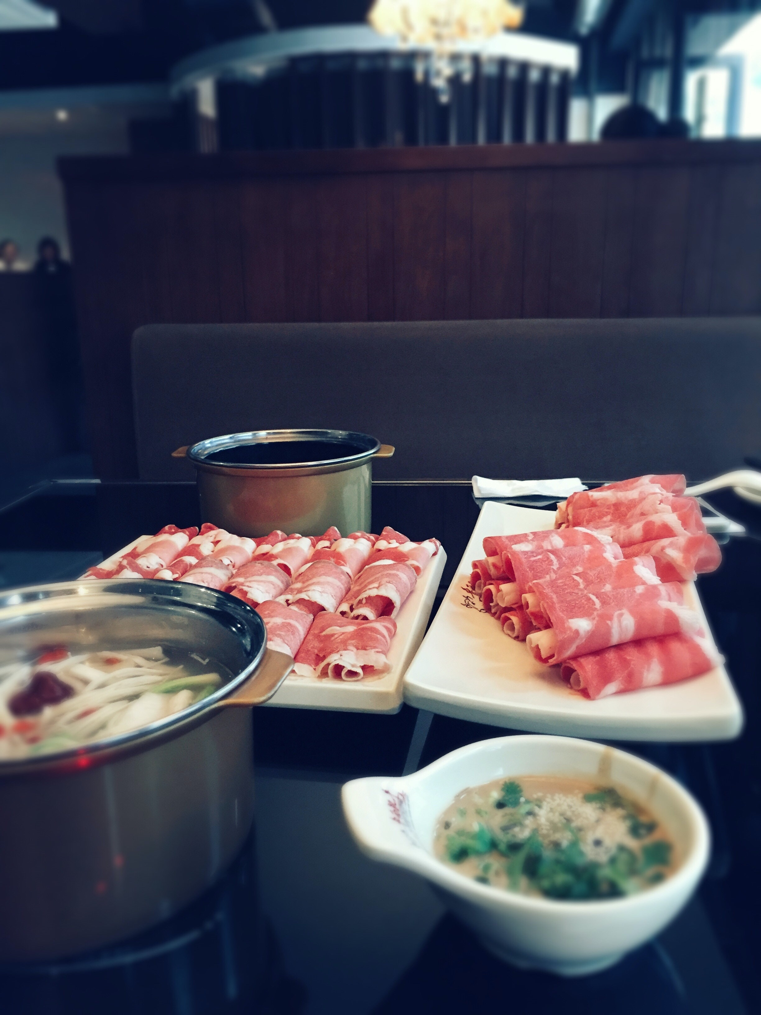 Rolls of raw meat and a bowl of soup at a hibachi restaurant