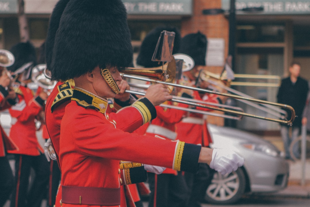 Palace guards in bearskin hats playing in a marching band for a parade