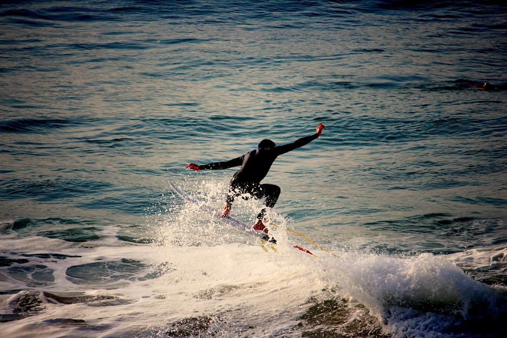 person wakeboarding on the sea