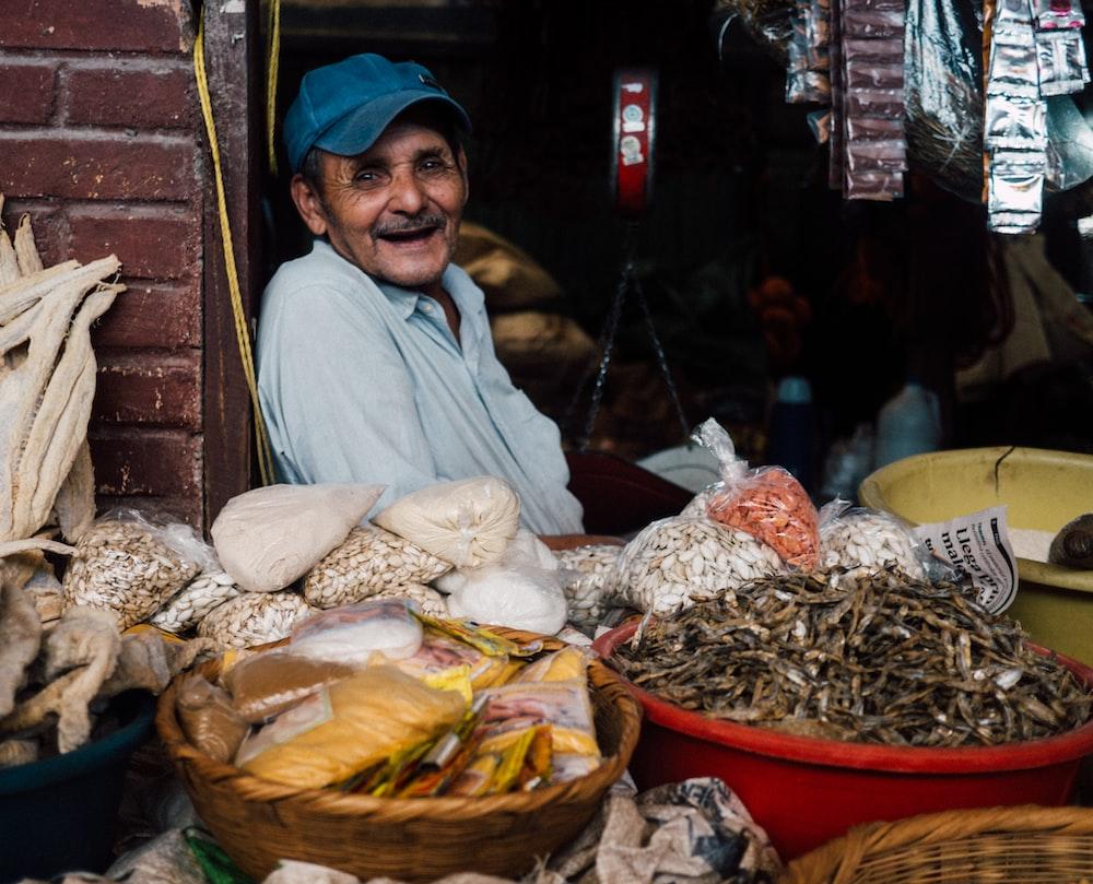 man in blue cap inside store