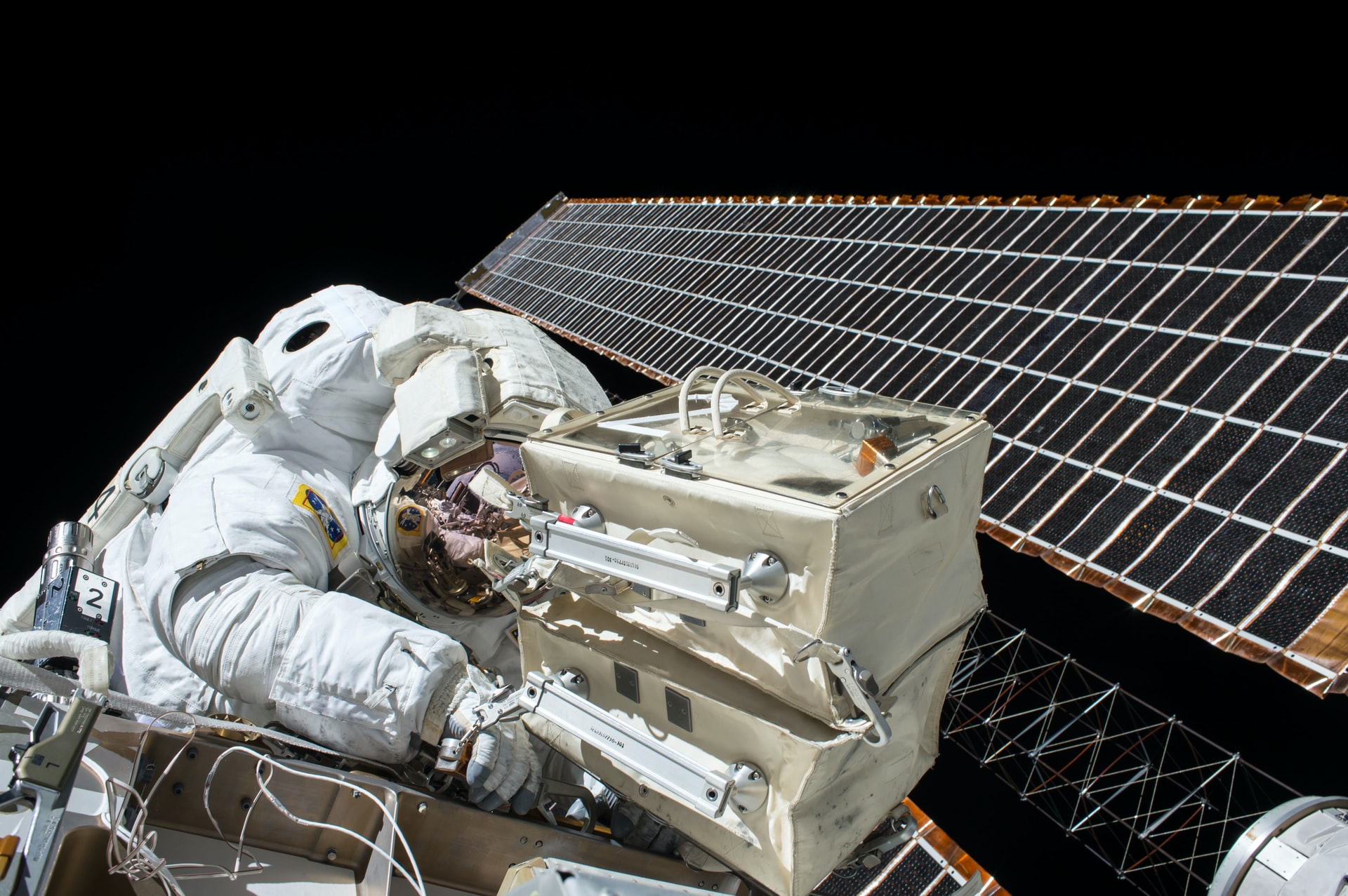 An astronaut is shown working outside of the International Space Station.