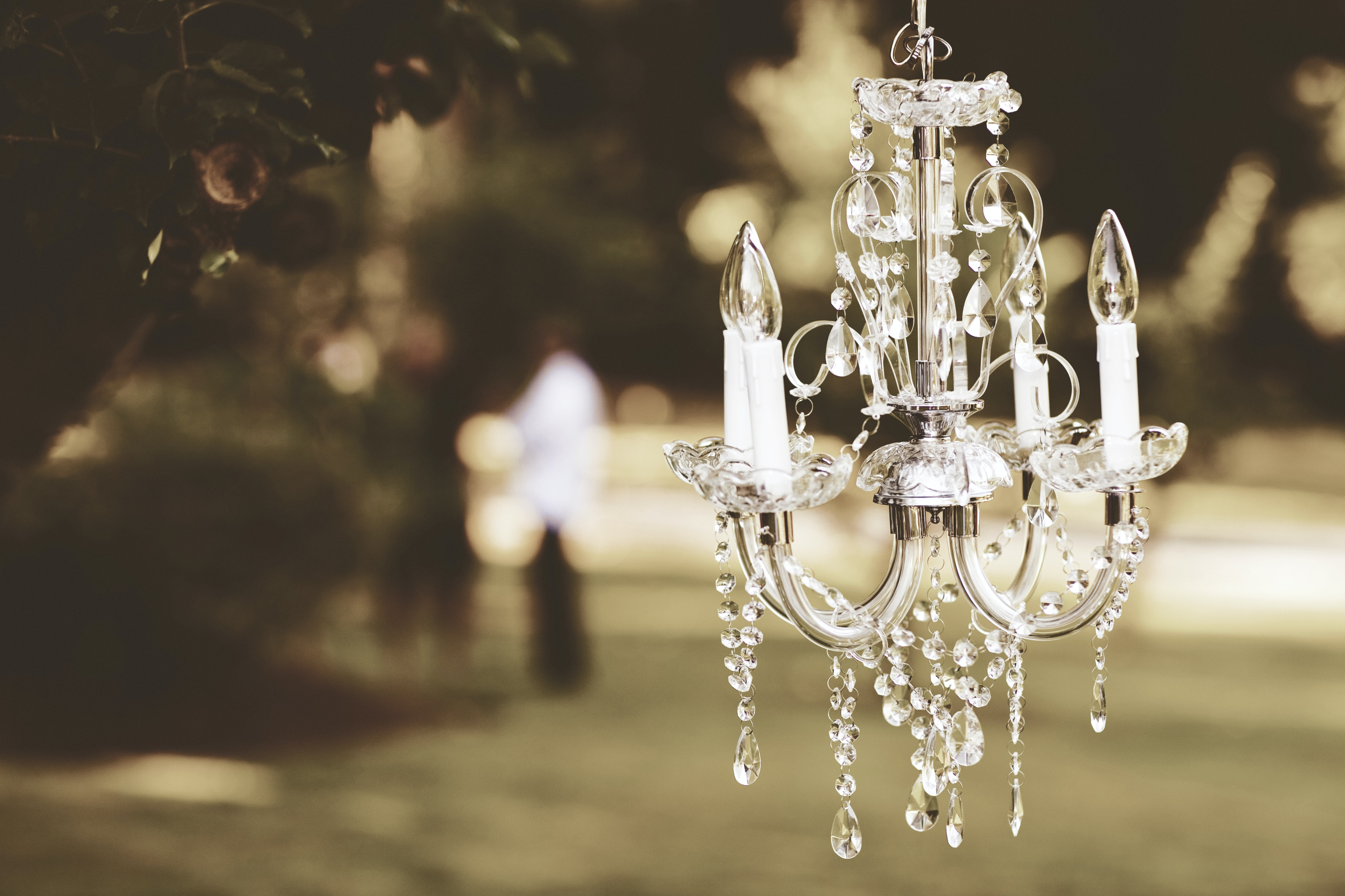 shallow focus photography of clear glass and silver chandelier