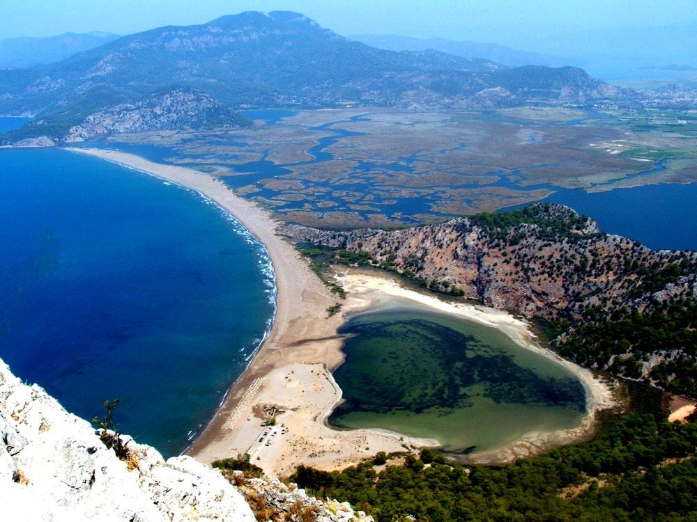 aerial view of seashore and mountains