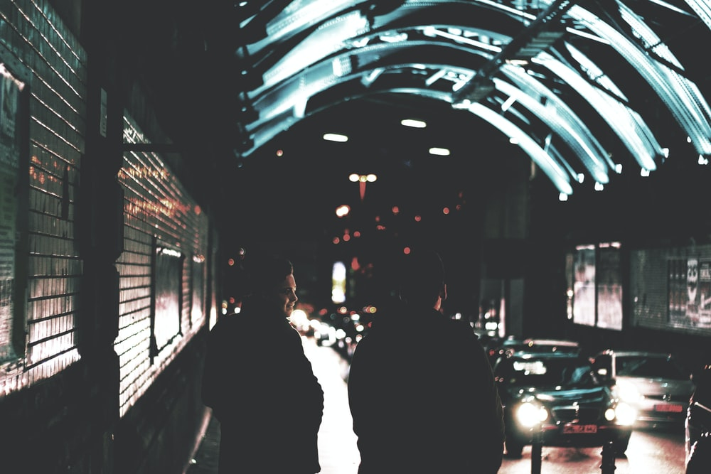two people standing near road