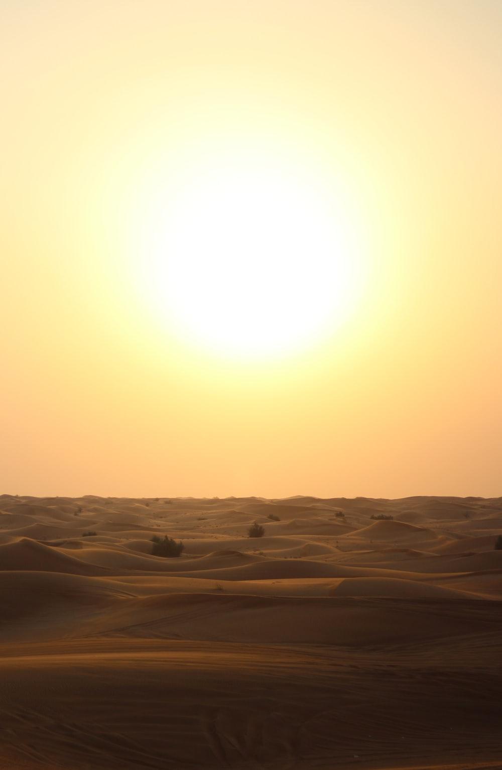 beige sand during sunset
