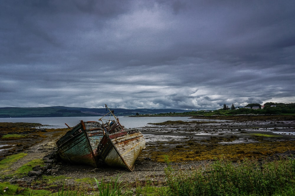 landscape photography of two boats near body of water