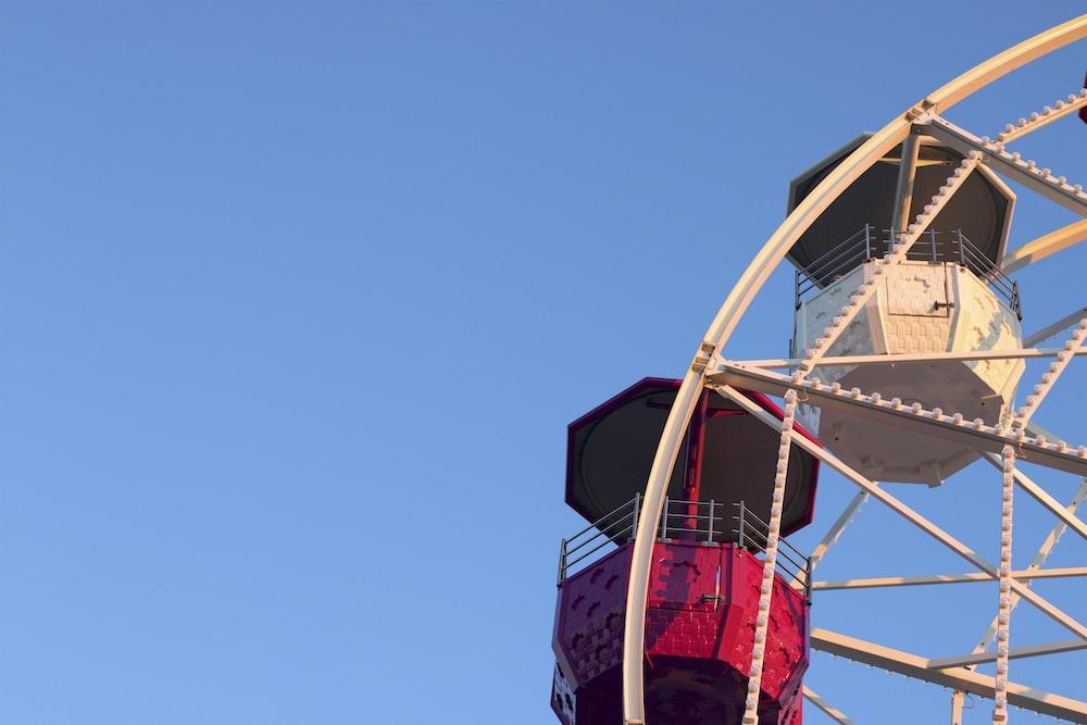 beige and red ferris wheel