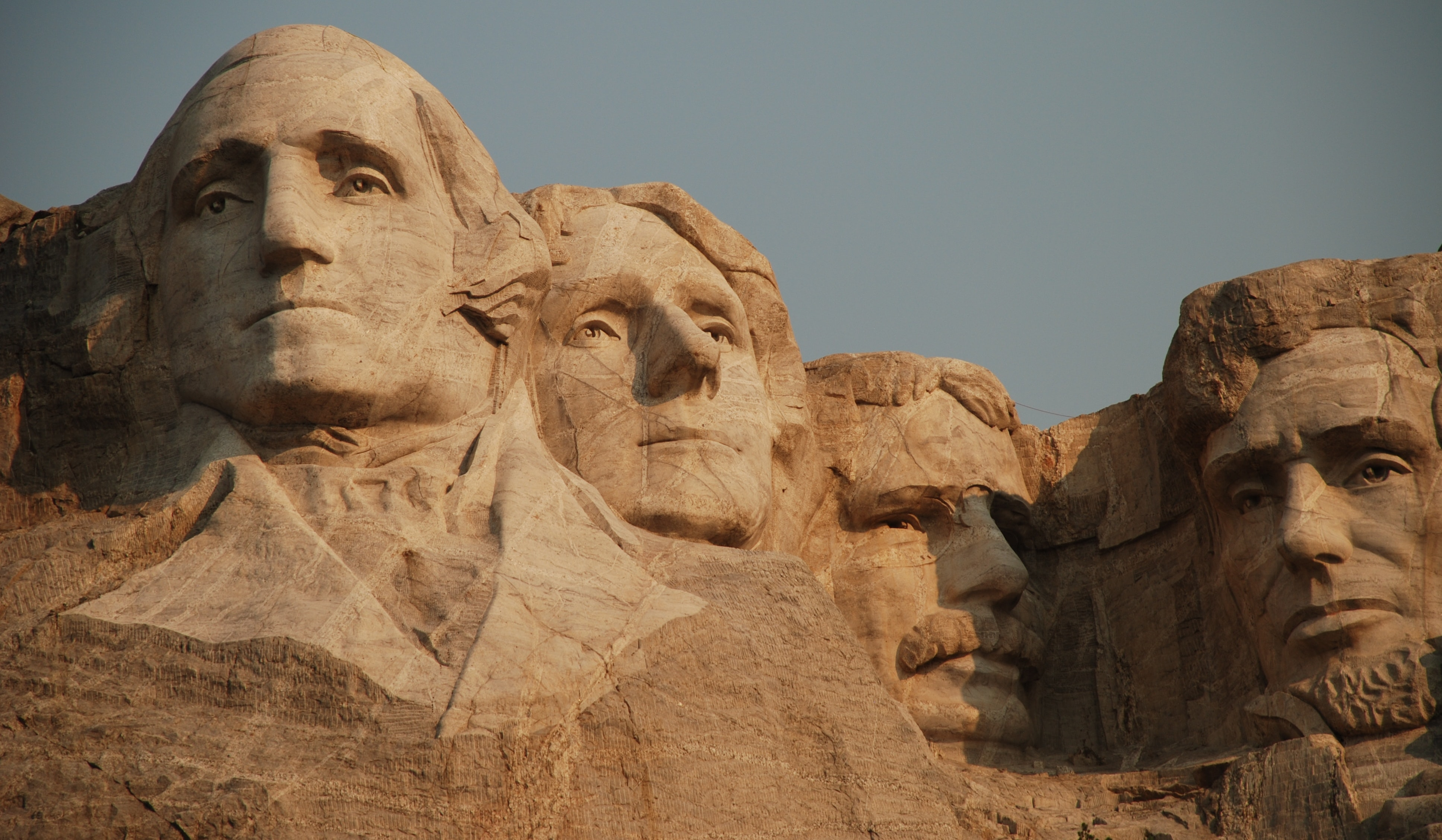 Daytime shot of stone Mount Rushmore sculpture in rock