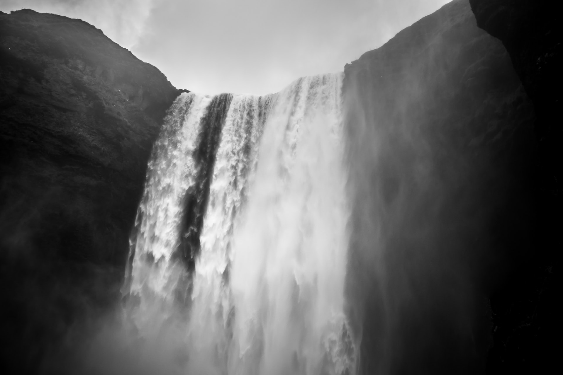 Black and white shot of a large waterfall