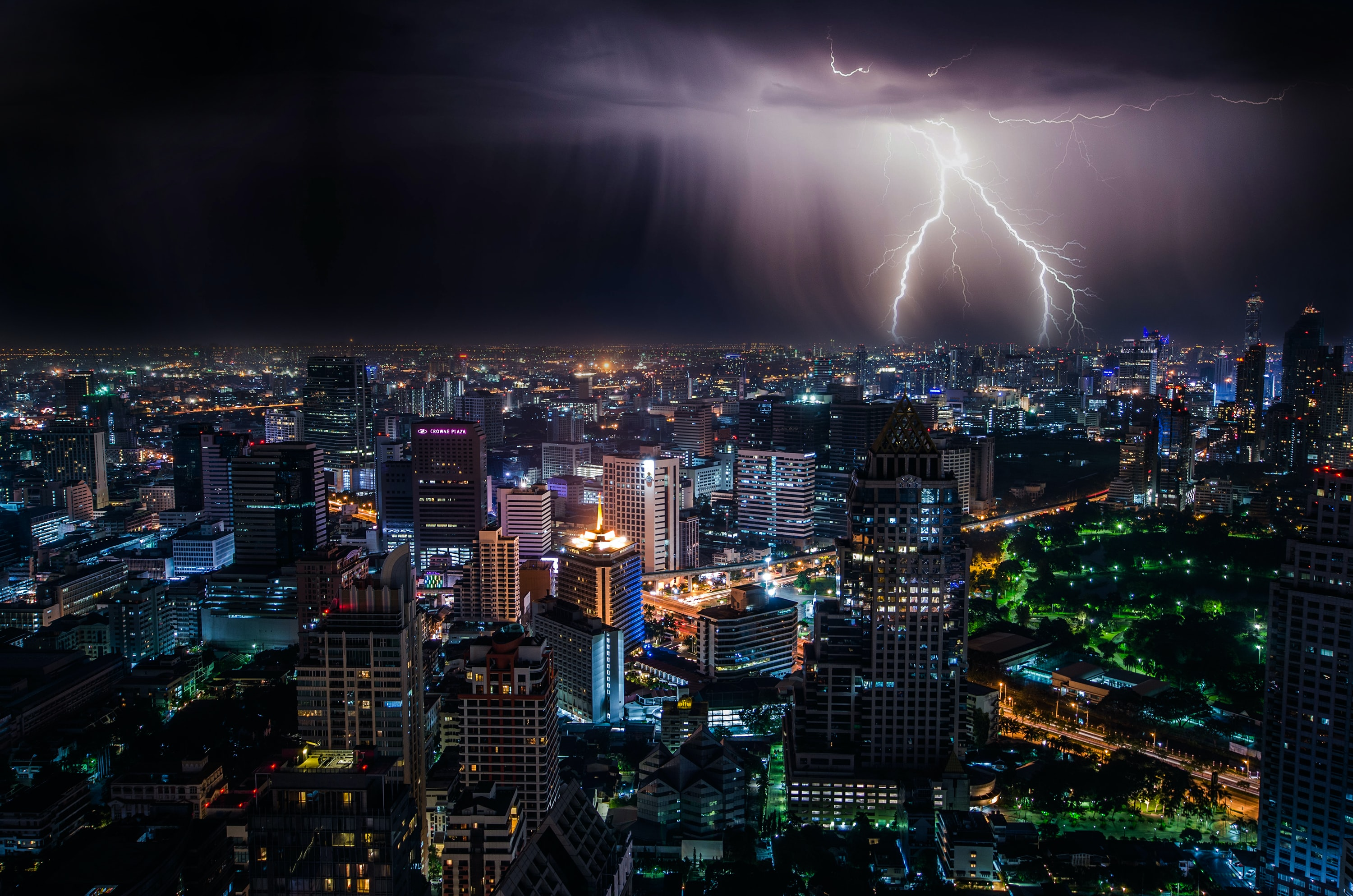 aerial view of city buildings with lightning strike