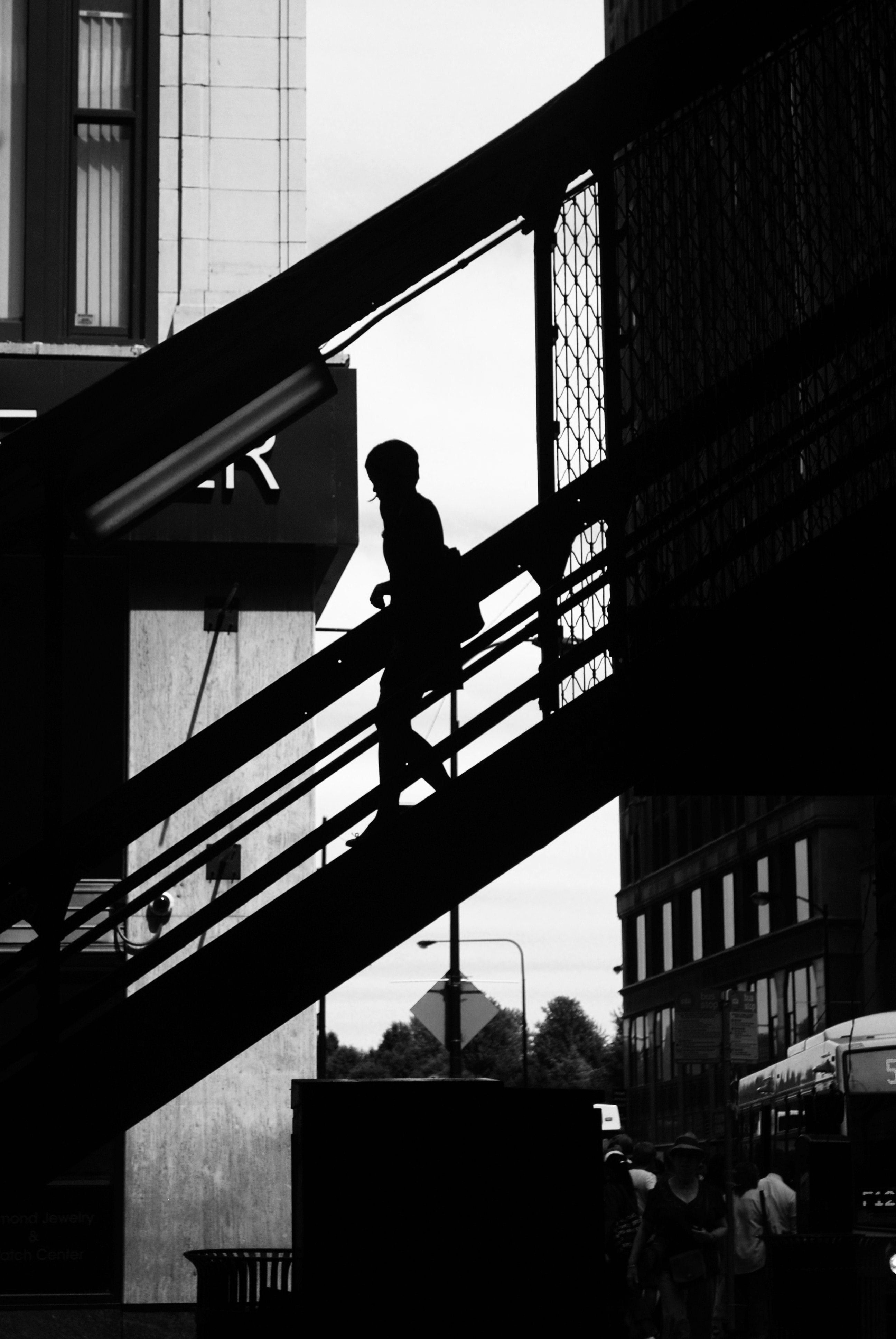 A silhouette shot of a woman walking down a staircase in Chicago.