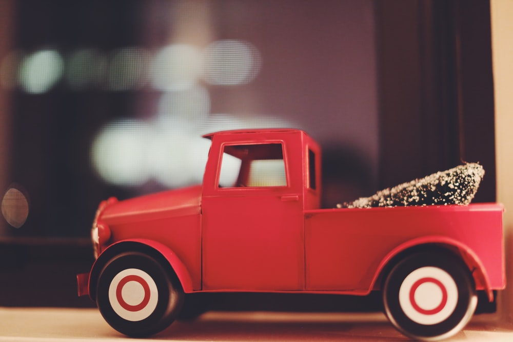 red toy car on white surface
