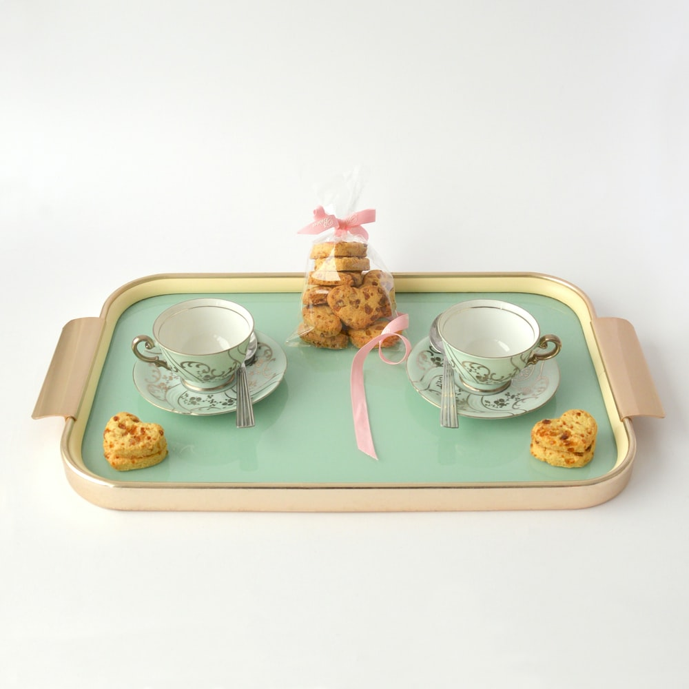 rectangular beige and green tea set and packed cookies