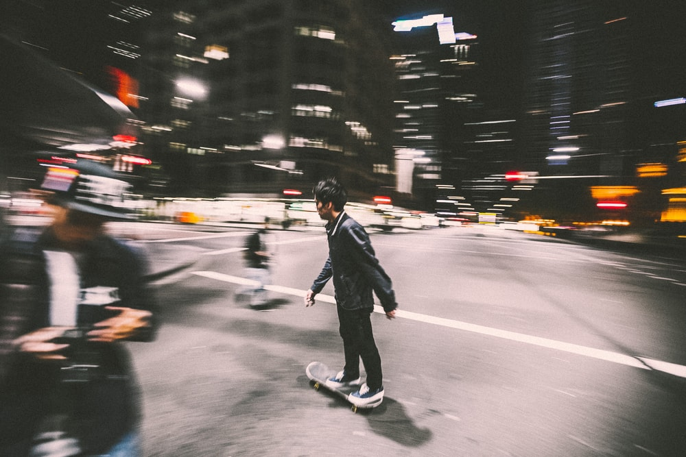 man riding on skateboard on street