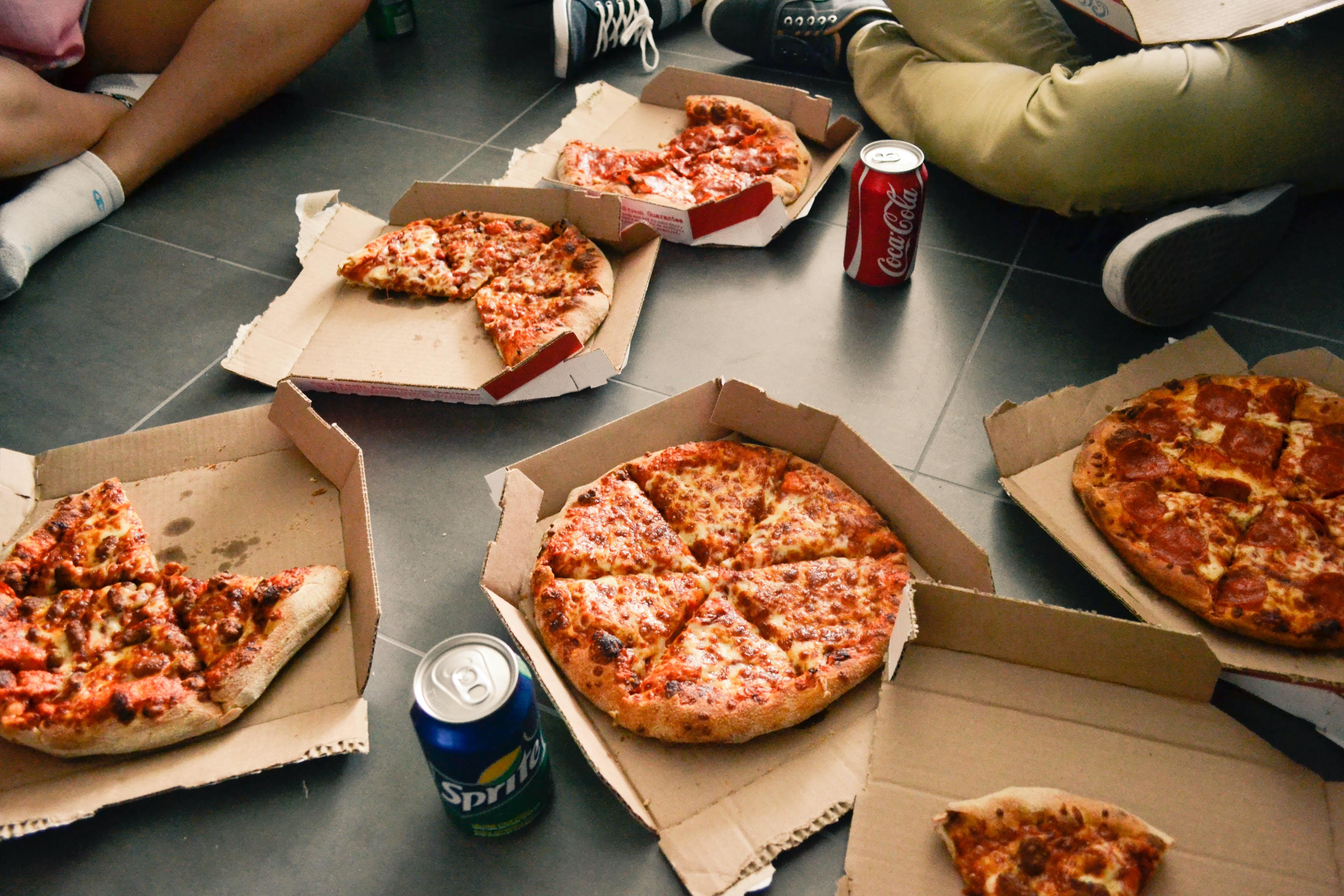 several sliced pizzas